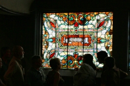 A tour group admires one of the many windows